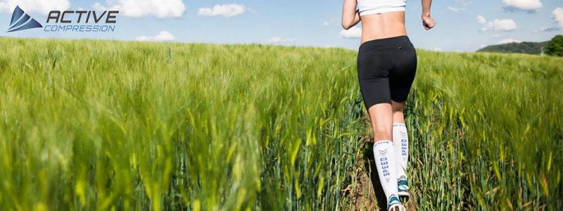 Billede af løber med Active Compression løbestrømper